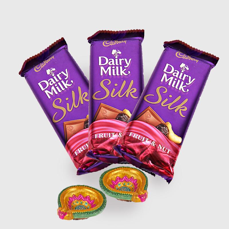 Diwali Hamper of Cadbury dairy milk silk with Diya