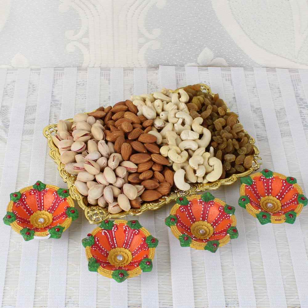 One Kg Assorted Dry fruit Tray with Four Earthen Diyas