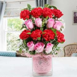 Carnations and Roses in a Glass Vase