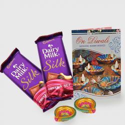 Diwali Hamper of Cadbury dairy milk silk with card and diya