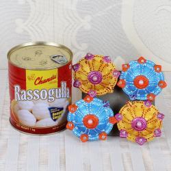 Earthen Diya and Rasgulla Sweets