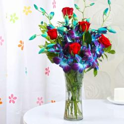 Exotic Glass Vase of Ten Orchids and Roses