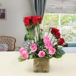 Pink and Red Roses in Glass Vase
